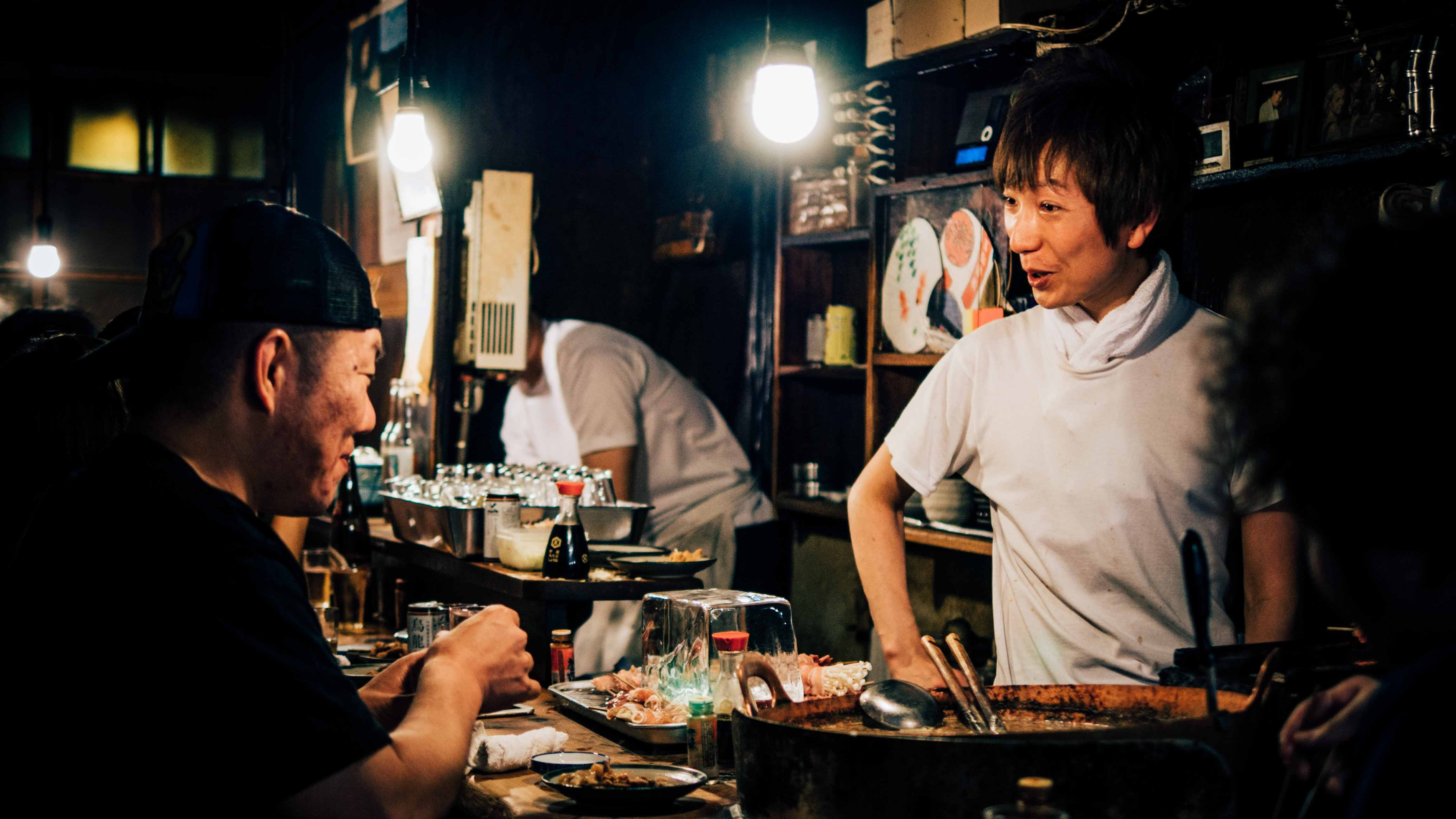 Japanese izakaya chef and diner