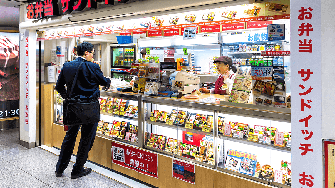 A commuter purchases an ekiben (station bento) from Tokyo Station before travelling on the shinkansen (bullet train)