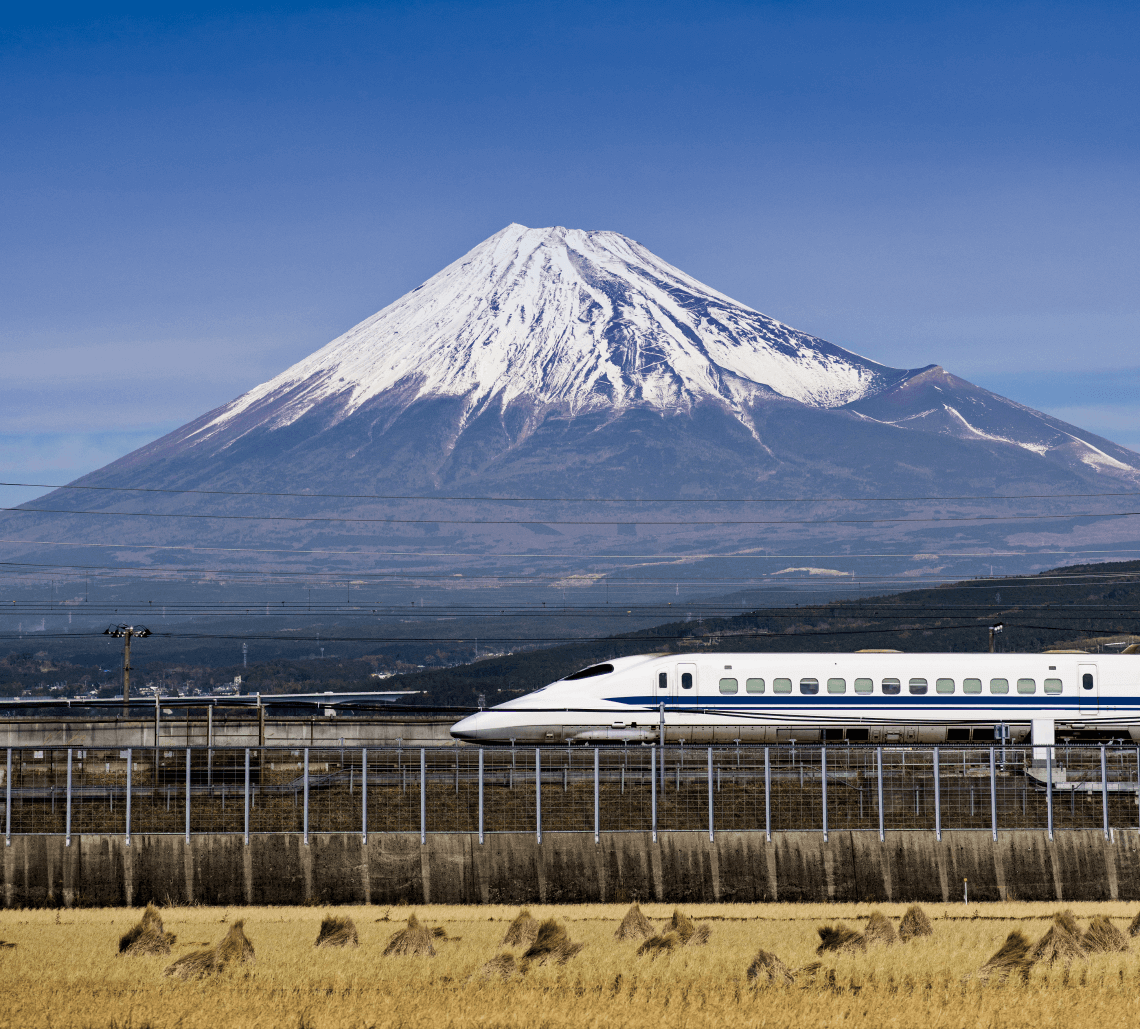 Shinkansen (bullet train) passing Mount Fuji, Japan