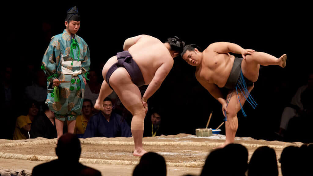 Sumo rikishi prepare to begin a bout at a basho in Japan